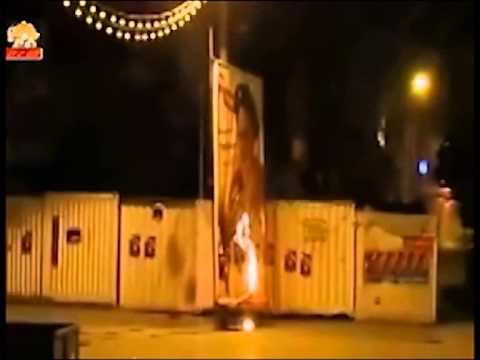 Iran - Khomeini's picture burned in Kermanshah