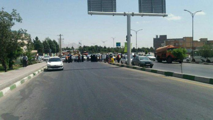 IRAN: Angry Protesters Block Road in Urmia