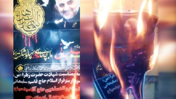 Iranian people torch Qassem Soleimani's images