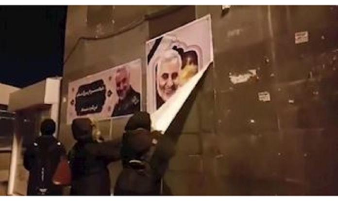Iran's rebellion youths tear and burn Qassem Soleimani's images