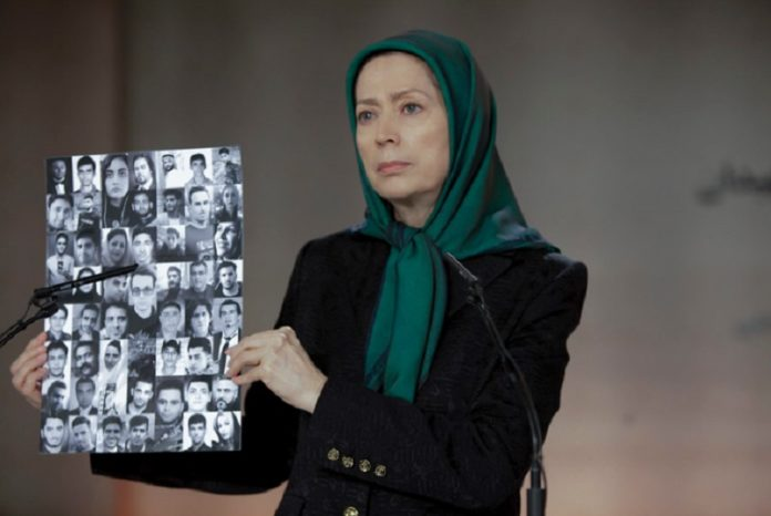Maryam Rajavi shows the images of protesters who were killed by Iran security forces at the ceremony of 40th day of martyrdom of the victims of the November uprising