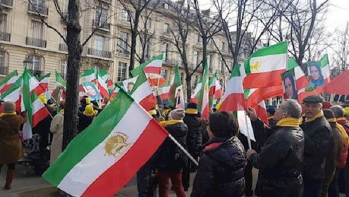 Iranians who support regime change and PMOI-MEK supporters rallying in Paris
