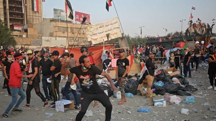 Iraqi protesters rallying against government corruption and Iranian regime meddling