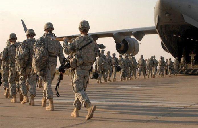 The U.S. warns Iran it will respond to attacks by Tehran allies in Iraq