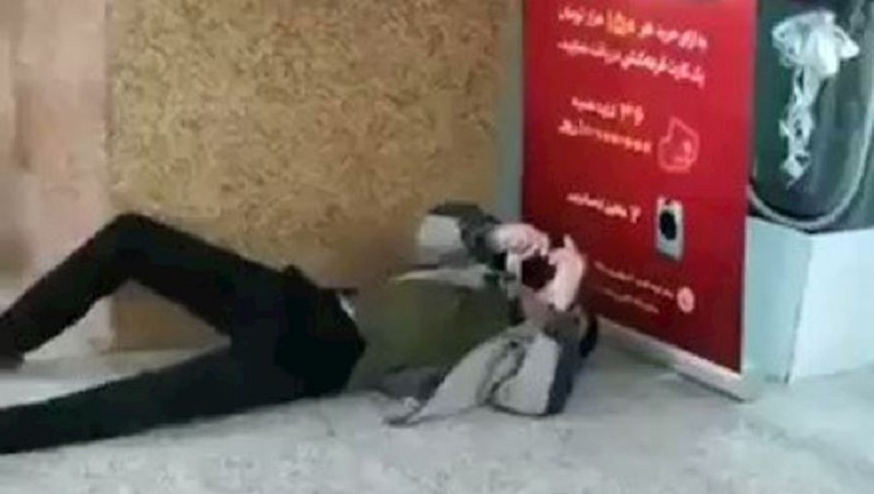 An Iranian citizen lies in a shop center because of contracting the coronavirus
