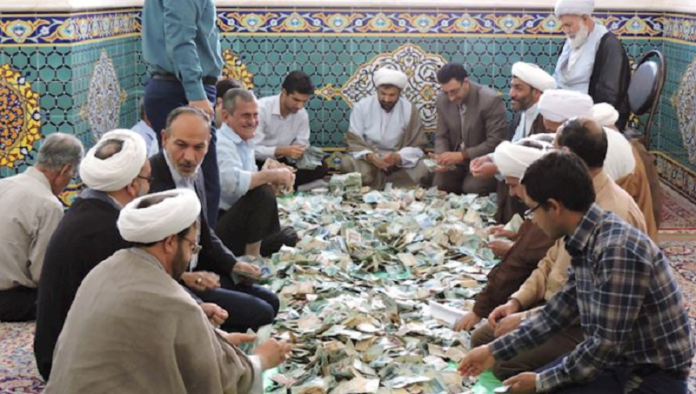 Iran's authorities and their relatives line their pockets with the people's charities in a shrine