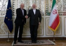 Javad Zarif shakes hands with Josep Borrell.