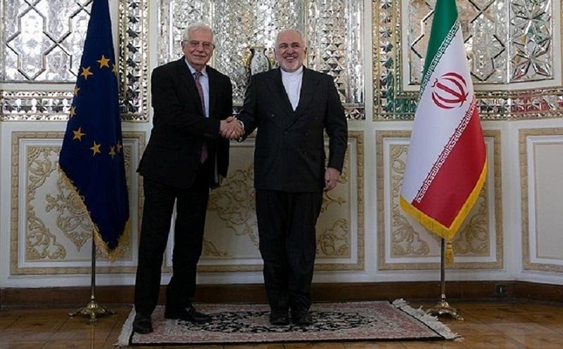 Javad Zarif shakes hands with Josep Borrell.