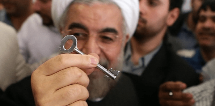 Iran regime's President Hassan Rouhani holding the symbolic all 'problems solving key'
