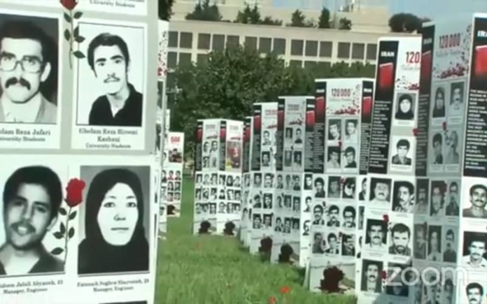 The NCRI's exhibition in front of the congress commemorating the 32nd anniversary of the massacre of 30,000 political prisoners by the ayatollahs