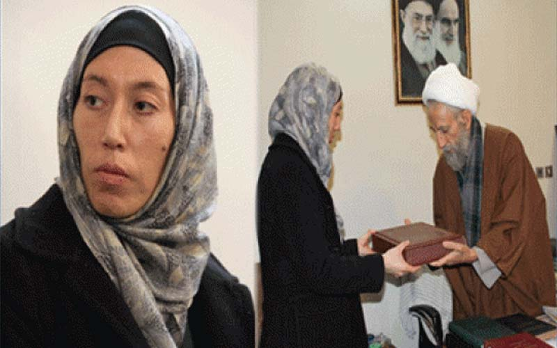 Iran's agent Monica Witt receives a gift from an Iranian mullah