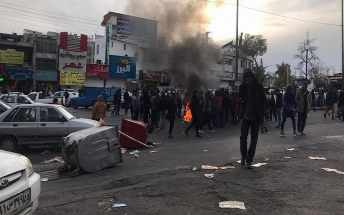 Iranian people take part in an uprising