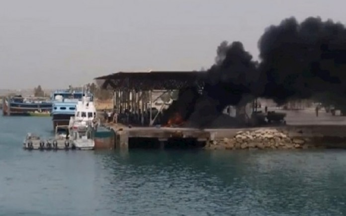 Angry Iranian people in revenge over the regime's brutality burnt the boats of the regime's forces on the Kuhestak port.