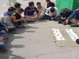 Iran's temporary workers sitting on the street margin in the hope of finding a job