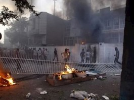 Iranian youth attack government centers in the November 2019 protests.