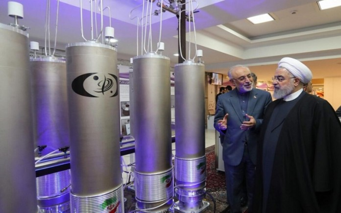 Iran regime's president Hassan Rouhani, watching the regime's nuclear facilities (Image: Archive)