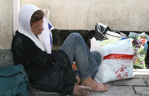 Iran, cardboard sleeping women