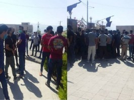 Izeh project workers and craftsmen gather in front of the governor's office of this city