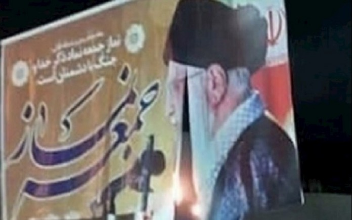 Khamenei's banner set on fire by Iranian youth