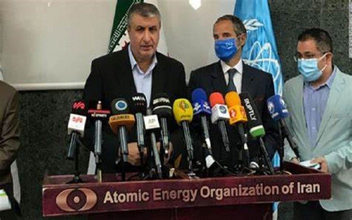 IAEA and Iran reach agreement to avert nuclear deal crisis.
