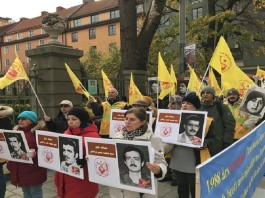 MEK supporters calling for the trial of mullahs' leaders, including Ali Khamenei and Ebrahim Raisi, for crimes against humanity.