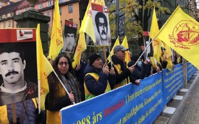 Iranians, supporters of the NCRI rally in Stockholm, Sweden in front of the court convicting Hamid Nouri one of the perpetrators of the 1988 massacre.